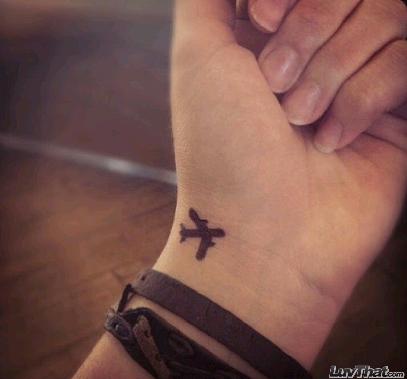 airplane wrist tattoo