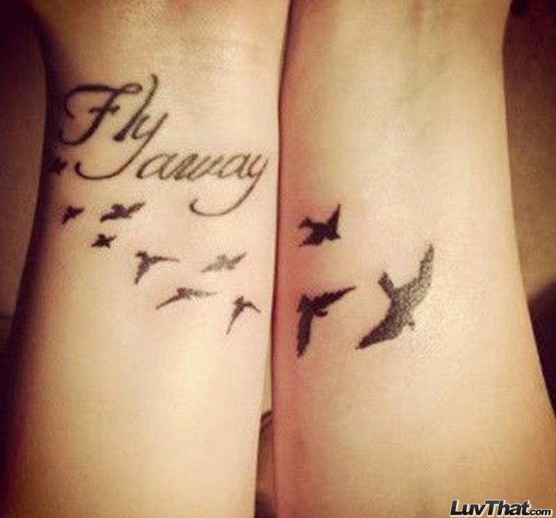 fly away text and birds wrist tattoo