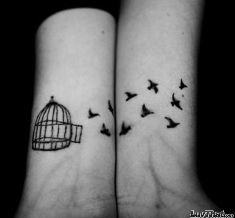 open cage and fly away birds wrist tattoo