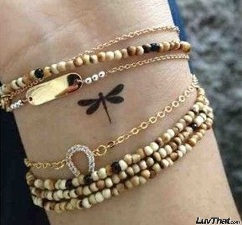 tiny dragonfly cute wrist tattoo