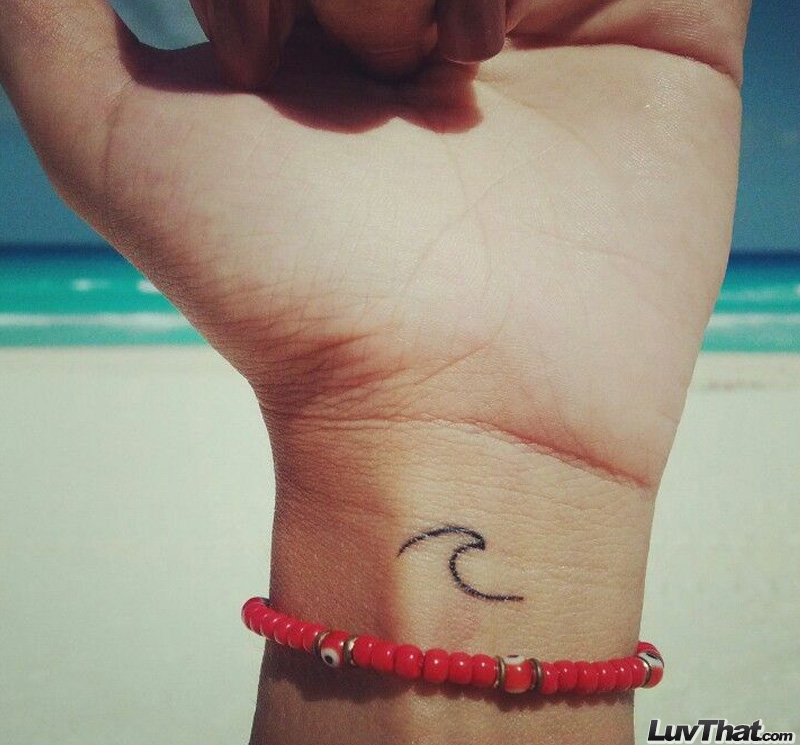 tiny wave wrist tattoo