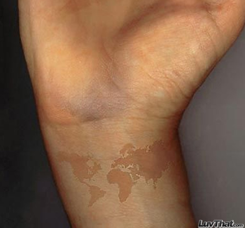 world map wrist tattoo