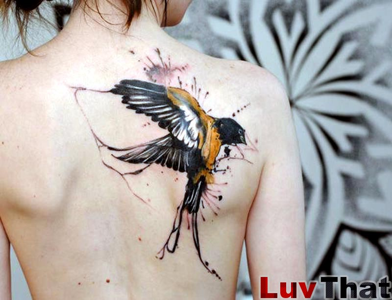 amazing watercolor tattoo bird sparrow black and gold on back
