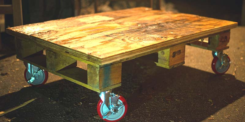 simple wood pallet coffee table red casters