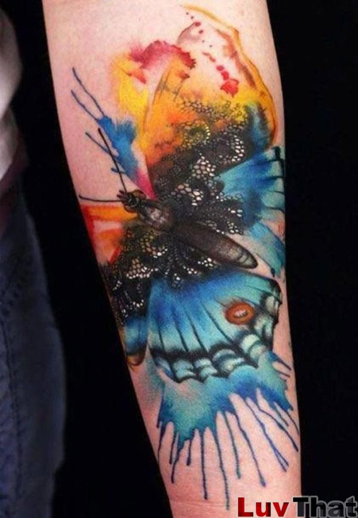 watercolor style huge butterfly tattoo on forearm
