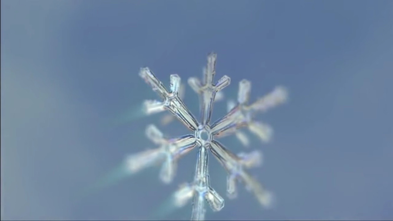 closeup of snowflake forming frozen planet