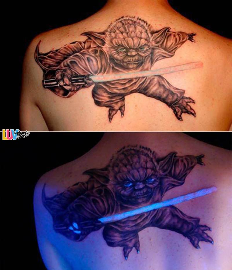 large yoda tattoo glow in the dark ink light saber