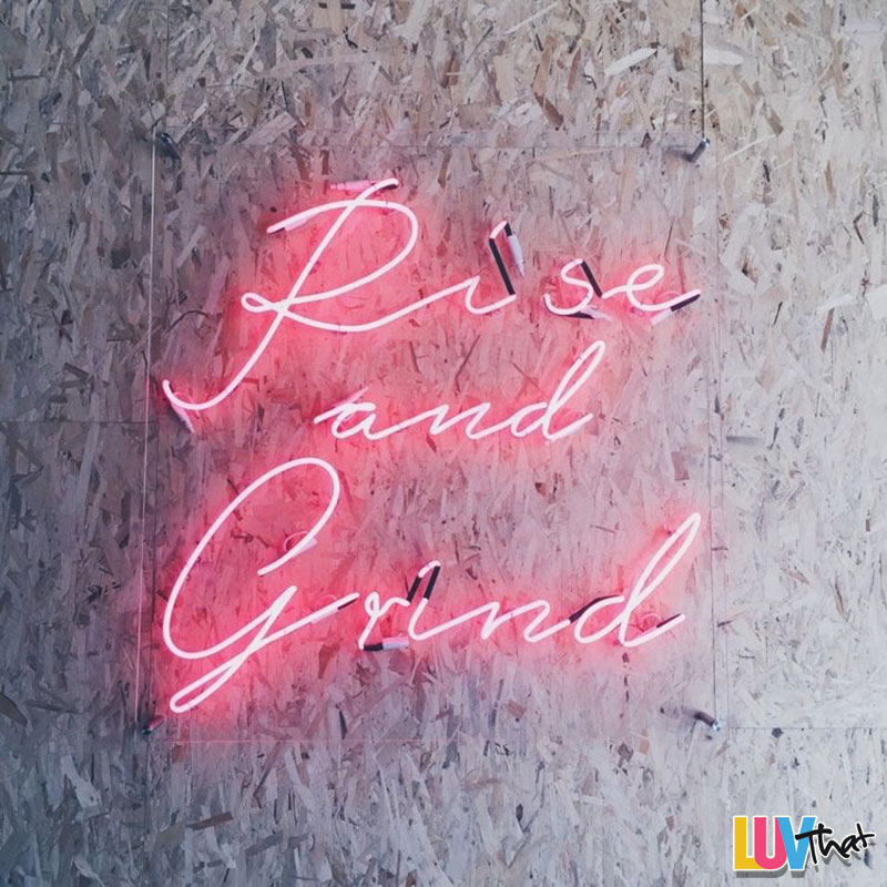 neon pink rise and grind sign