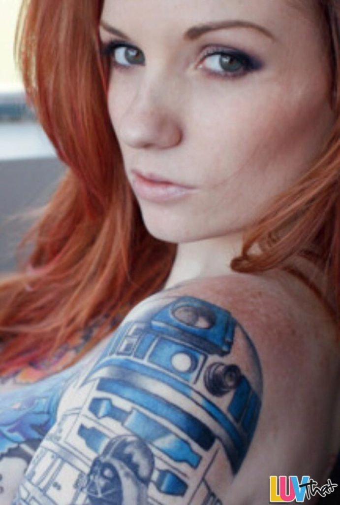 redhead with R2D2 shoulder tattoo