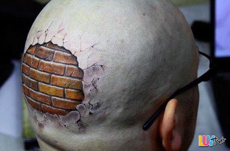 brick wall under skin head tattoo
